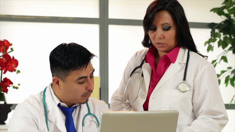 Tilt Doctor Confering With A Woman Doctor stock footage