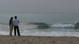 A Couple Looks At The Waves,Mahabalipuram,India stock footage