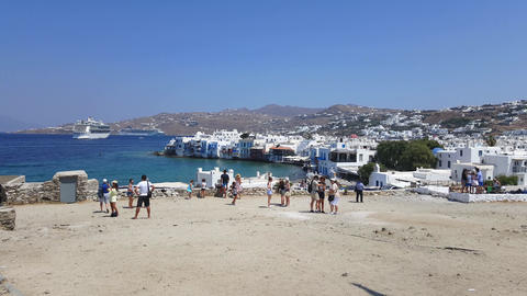 Mykonos Town, Greece – summer 2015. Tourists at the windmills gazing Little Ve Footage