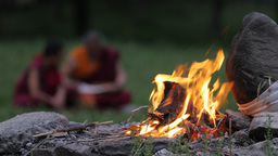 Buddhist Teacher And Student With Focus On Fire,Rewalsar,India stock footage
