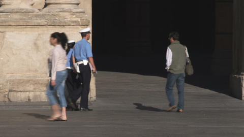 Italian Police Walking Through A Plaza In Bologna Italy stock footage