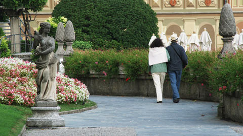 People Walking Through Gardens Near Lake Como In Italy stock footage