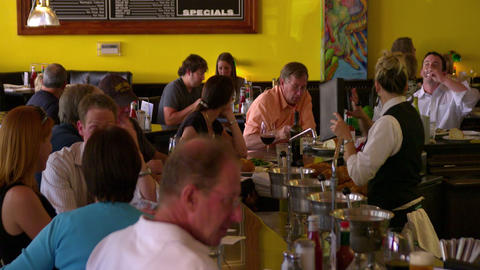 Bar Tender Serves People Seated At The Bar stock footage