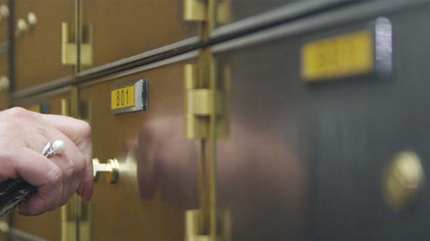 Close-up Of Hand And Key Opening A Safety Deposit Box stock footage