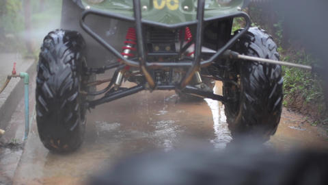 Wash ATV With High Pressure stock footage