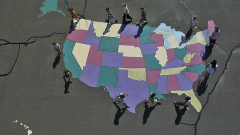 Aerial Shot Of Children Walking Around A Painted USA Map On The Floor In Utah stock footage