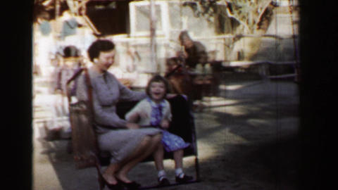 1957: Horse Powered Amusement Park Chair Ride Kids Enjoy The Ride stock footage