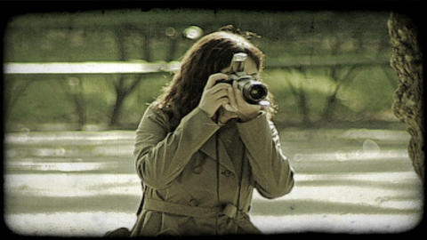 Woman Takes Picture. Vintage Stylized Video Clip stock footage