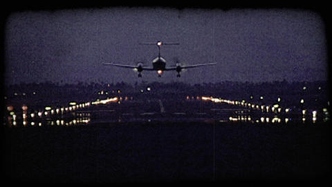 Plane lands on runway. Vintage stylized video clip Footage