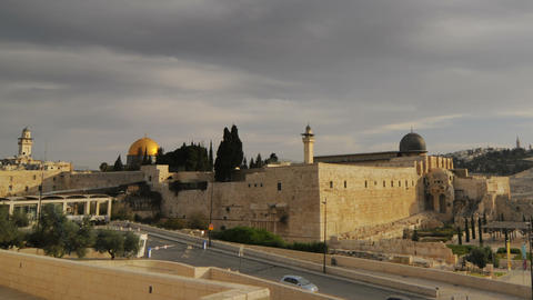 Panning Shot Of Low-angle Time Lapse Of Street Below Dome Of The Rock stock footage