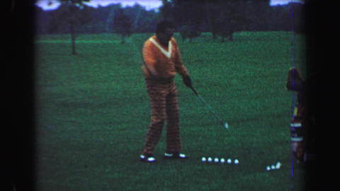 1969: Golfing Trick Shot Professional Performance Man Alternates One Handed Hits stock footage