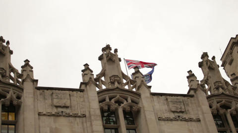 Union Jack Flying Above An Ornate Rooftop Near Westminster Palace stock footage