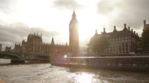 Sun Glare Behind Big Ben And Westminster Palace In London, England stock footage