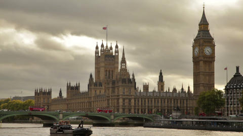Boat Glides Across Thames River In Front Of Westminster Palace In London, Englan stock footage