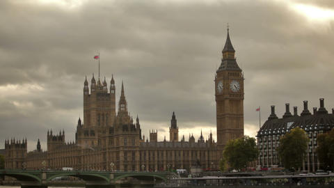 Westminster Palace From Across Thames River With Dark Storm Clouds In Background stock footage