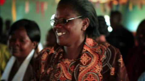KENYA-C. 2012 Women And Men Sing And Dance At An Indoor Social Gathering In Keny stock footage