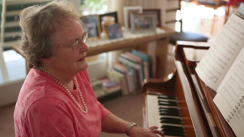 A Handheld Shot Of An Senior Woman Playing The Piano stock footage