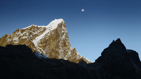 Time-lapse of the moon passing by Himalayan peaks at sunrise Footage