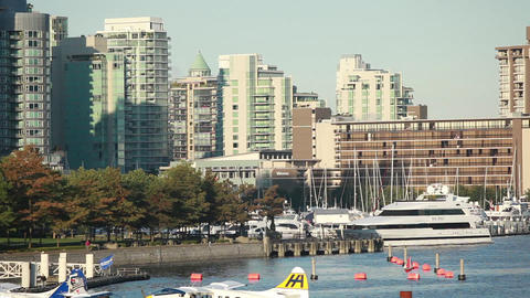 Panning Zoomed Shot Of The Olympic Village Down To The Water Where Planes Are Do stock footage