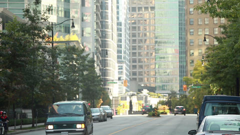 Static Shot Of Traffic In Vancouver As Cars And People On Bikes Ride By stock footage