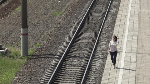 Woman Walking along The Railway stock footage