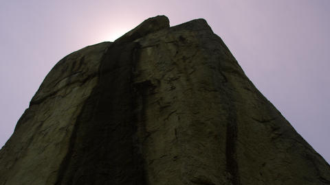 Low Angle Footage Of Enormous Rock stock footage