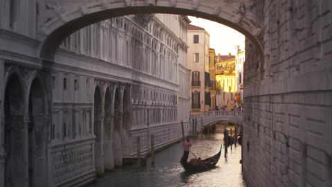 Panning Down From The Bridge Of Sighs To A Gondola Floating The Canal Below stock footage