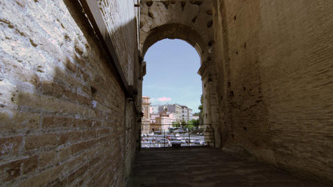 Italian Buildings And Cars Seen Through A Colosseum Arch On A Sunny Day stock footage