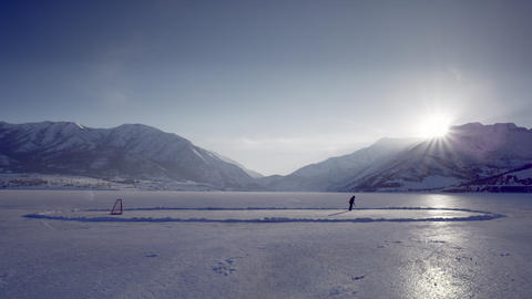 Someone playing hockey on a frozen pond Footage