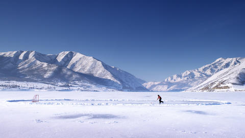 Hockey player on a frozen lake Footage