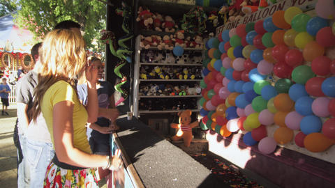 Shot Of Boy And Girl Playing Dart Game At A Carnival stock footage
