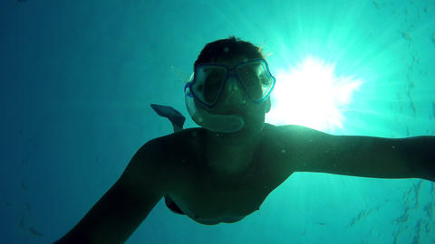 Young Man Swimming To The Surface From The Bottom Of The Sea stock footage