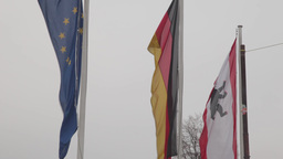 Flags Of Germany And The European Union Waving In The Wind stock footage