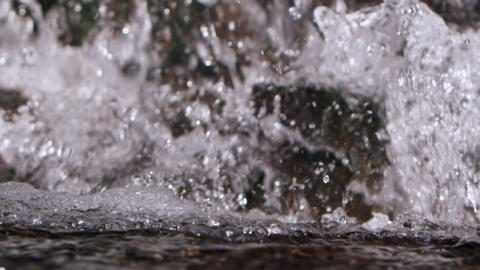 Slow Motion Closeup Of Water Crashing At The Bottom Of A Waterfall stock footage