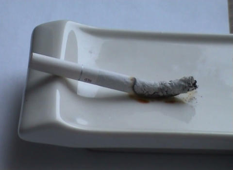 Decaying Cigaret In An Ashtray stock footage