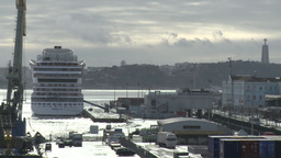 Cruise Ship Docked In The Port Of Lisbon With Holy Christ Statue In Background stock footage