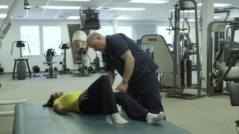 Physical Therapist Working With Woman's Leg stock footage