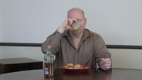 Man Eating A Meal And Drinking Liquor stock footage