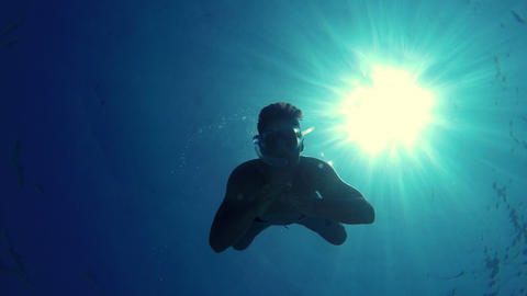 Young Man Swims Towards The Camera, Grabs It And Makes The Cut stock footage