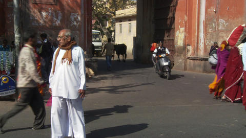 Man Crosses The Street In A Central Area Of An Indian Town stock footage