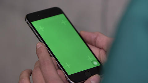 Up Close Shot Of Someone Using Smartphone With Green Screen stock footage
