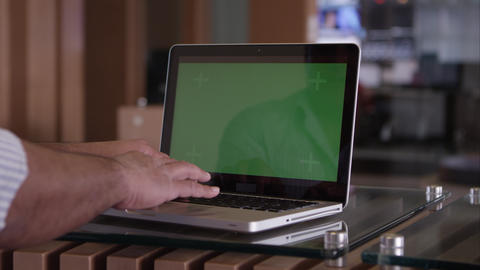 Panning Shot Of Person Scrolling Touch Pad On Laptop With Green Screen stock footage