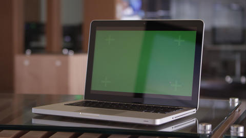 Panning Shot Of Laptop With Green Screen On Table stock footage
