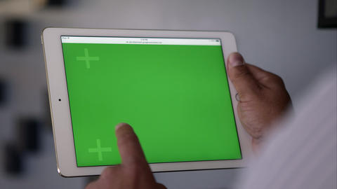 Up Close View Over The Shoulder Of Person Using Tablet With Green Screen stock footage