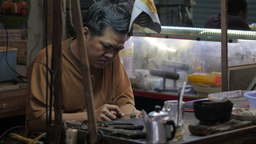 Man Repairing Jewelry In Market,Siem Reap,Cambodia stock footage