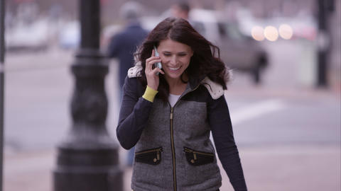 Close View Of Woman Walking Down The Sidewalk Answering Call On Cell Phone stock footage