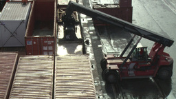 Forklift Tractor Moving Metal Shipping Containers In HarborForklift Tractor Movi stock footage