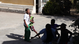 African Boys Playing Football In The School Playground In Cape Verde Africa stock footage
