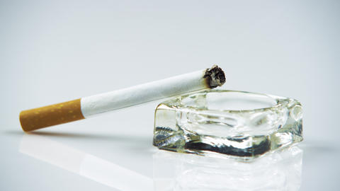 Lit Cigarette In An Ashtray Close Up stock footage