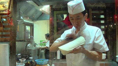 Chinese Chef Making Knife Cut Noodle stock footage